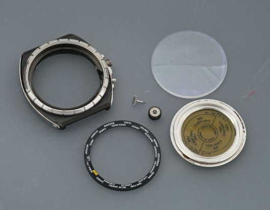 Disassembled watch case parts