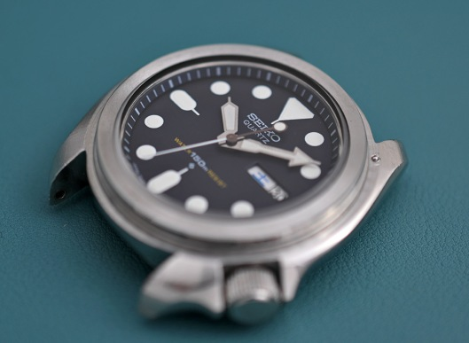 Movement refitted to the case, viewed from the front.  The bezel is not yet fitted