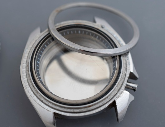 A Seiko 7548 watch case with the crystal retaining ring removed