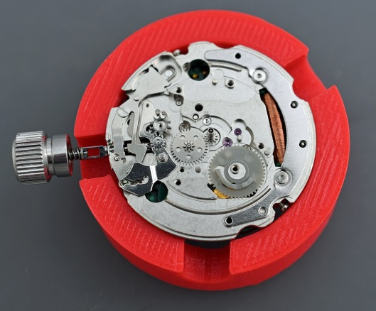 The calendar side of the movement showing the plastic day/date driving wheel
