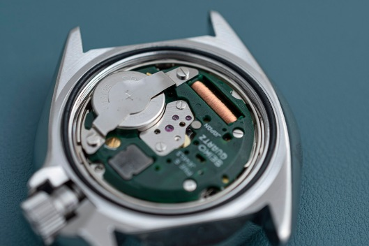 A fresh battery fitted to the movement