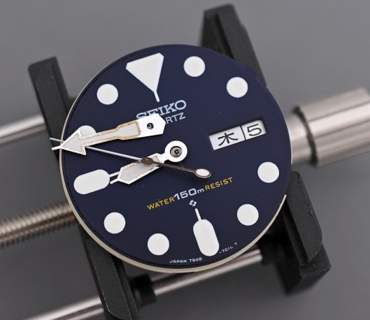Seiko 7548 dial with hands removed and resting on the dial